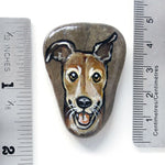 "hand painted rock art of a smiling brown greyhound dog, next to two rulers to show its size: 1 3/4"" x 1 5/16"" or 4.5 cm x 3.3 cm"