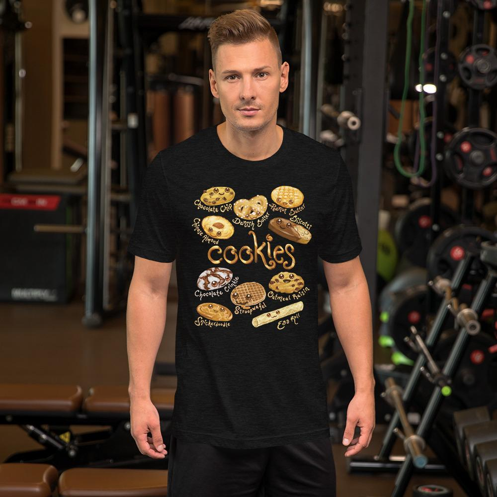 A man wearing the Happy Cookies Premium Unisex T-Shirt in the colour black heather, featuring artwork of ten different types of cookies with smiling faces