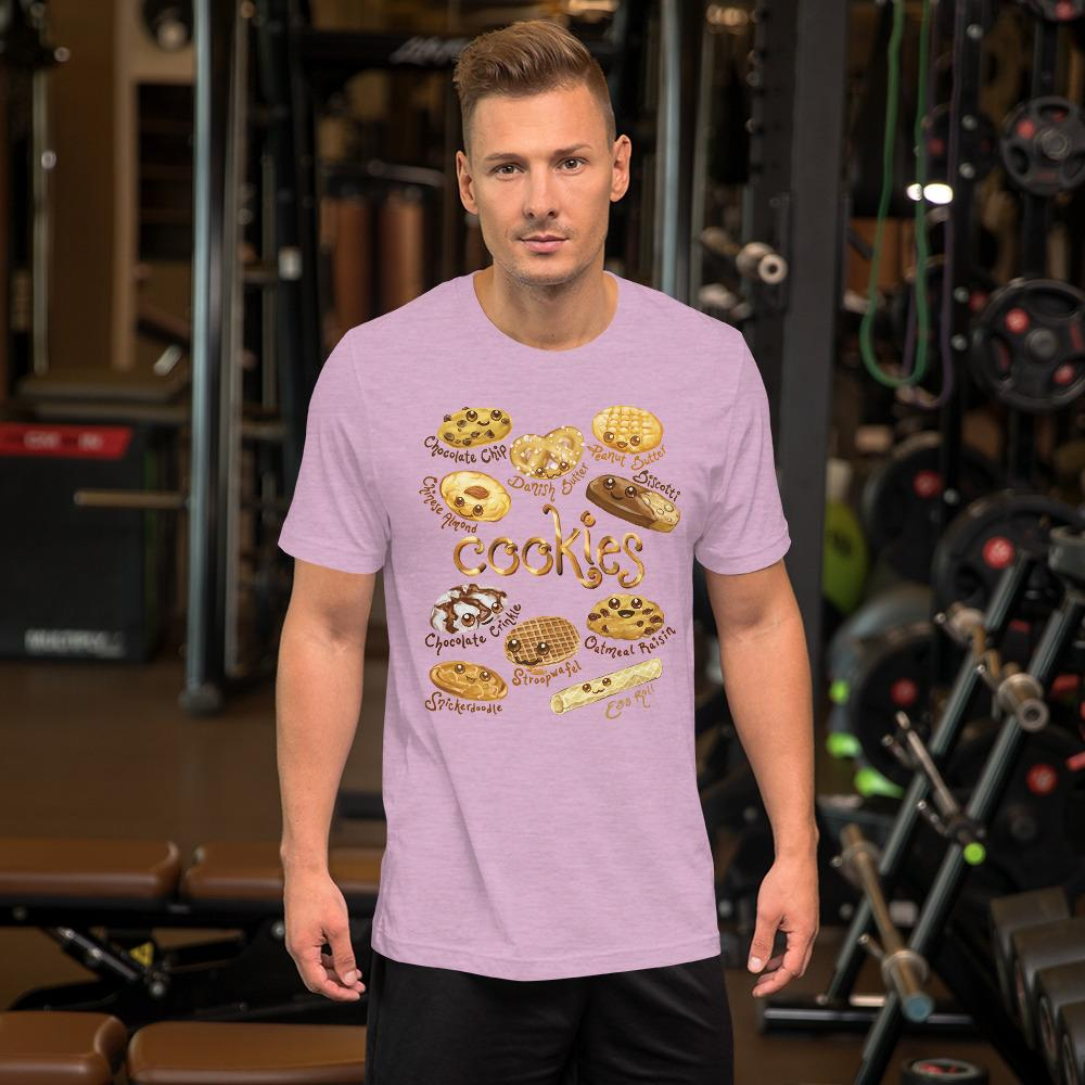 A man wearing the Happy Cookies Premium Unisex T-Shirt in the colour heather prism lilac, featuring an illustration of ten different types of cookies with smiling faces