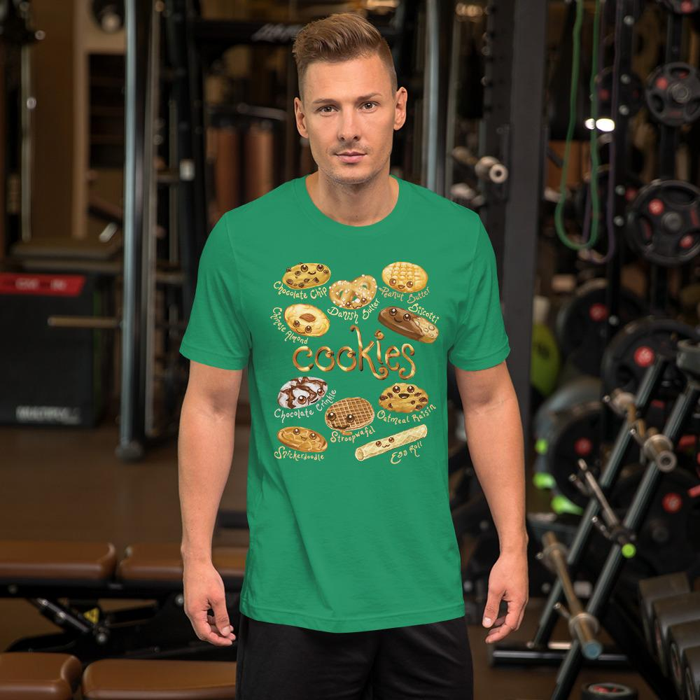 A man wearing the Happy Cookies Premium Unisex T-Shirt in the colour kelly green, featuring art of ten different types of cookies with smiling faces