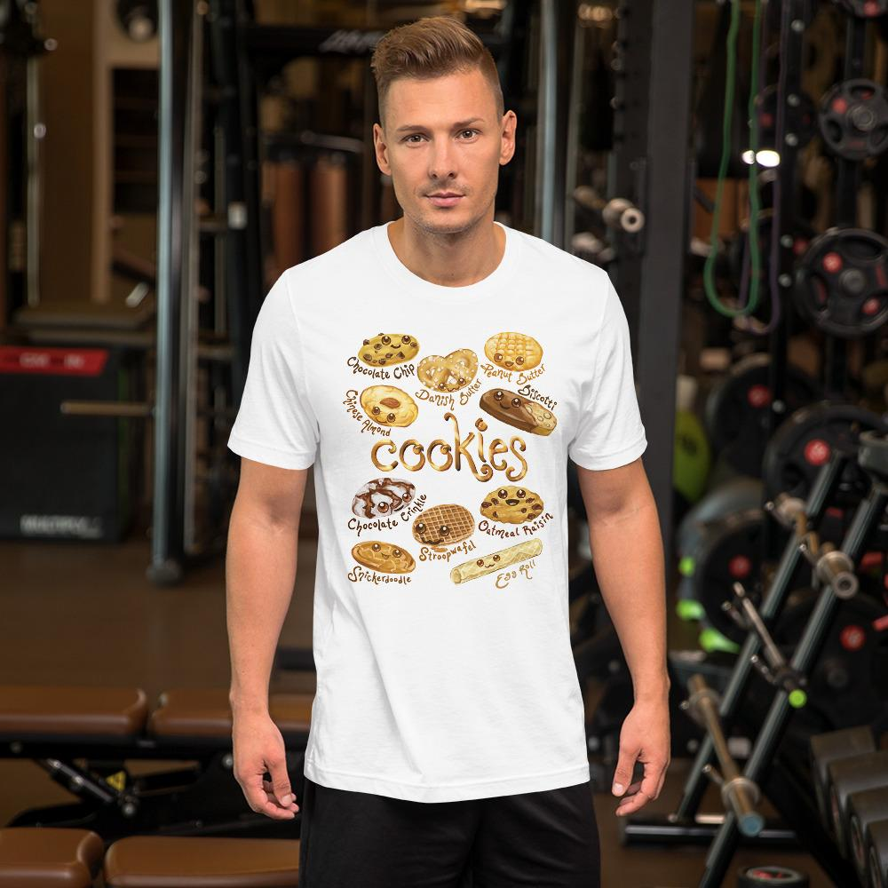 A man wearing the Happy Cookies Premium Unisex T-Shirt in the colour white, featuring art of ten different types of cookies with smiling faces