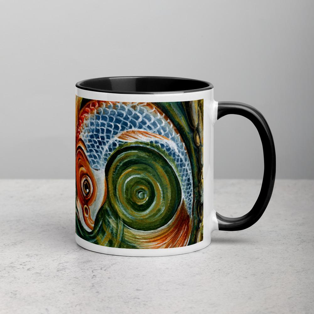 An 11 oz ceramic mug, with black trim, printed with art of a koi fish, part of the World card from the Animism Tarot