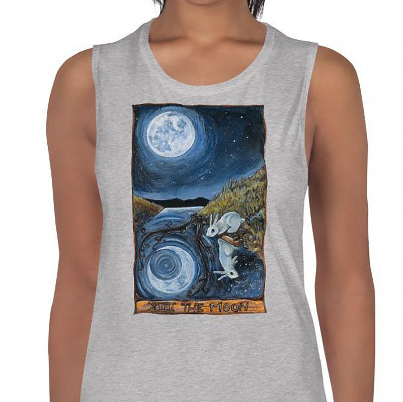 A woman is wearing the Women's Muscle Tank Top, in the colour athletic heather grey, which is printed with an image of The Moon tarot card from the Animism Tarot