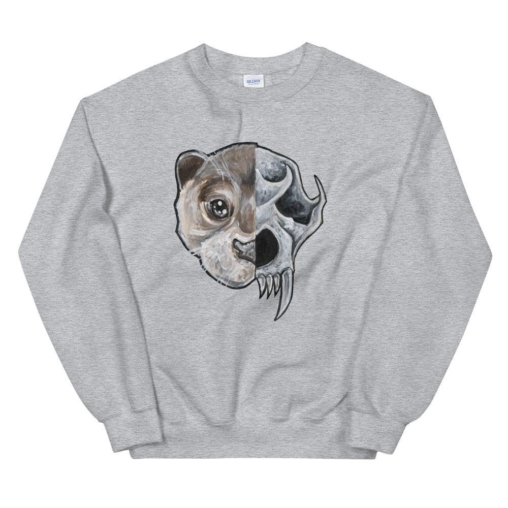 A unisex sweatshirt in the colour sport grey, printed with art split into two: the left side features the face of an otter, and the right side features an evil looking otter skull.