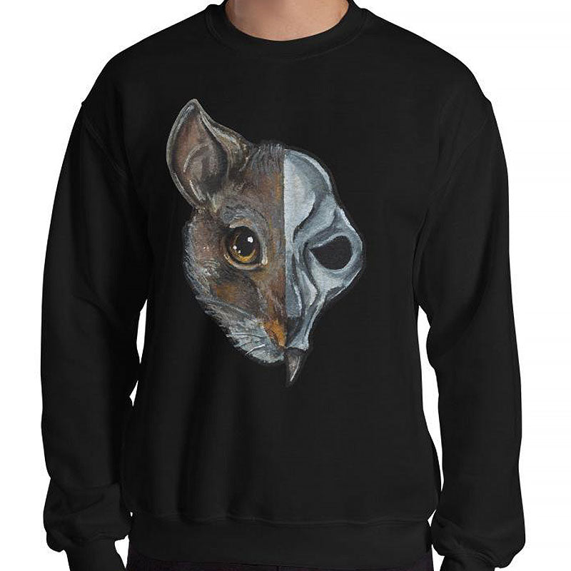 A man is wearing a unisex sweatshirt in the colour black, which is printed with a split illustration: the left side features the face of a brown rat, and the right side features an evil looking rat skull
