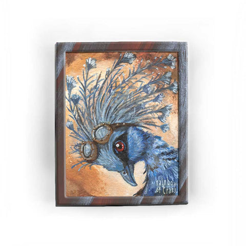 An art print with a portrait of a Victora Crowned Pigeon with steampunk goggles on its head