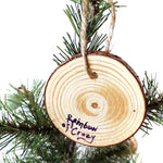 The back of a wood Christmas ornament, signed with, Rainbow of Crazy