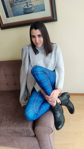 Model wearing business outfit with blue tartan leggings