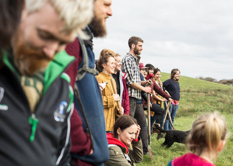 Group of people gathering to plant Native Irish Trees across Ireland's Woodlands for charity.