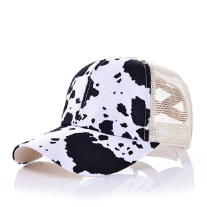 Black & White Cow Print Pony Tail Hat
