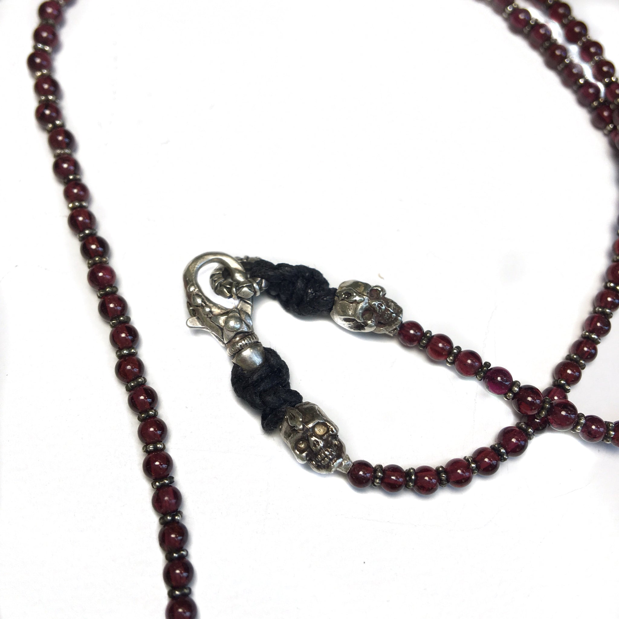 Garnet and Silver Skull Cross Necklace