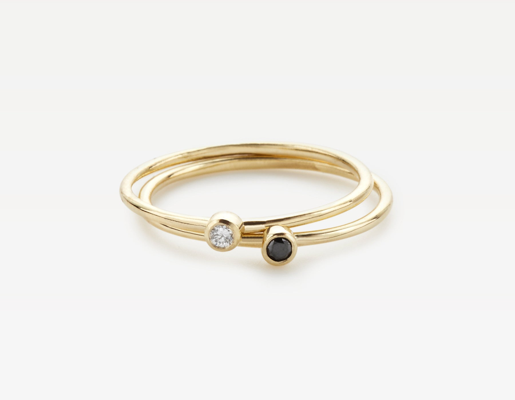 White & Black Diamond Circle Stacking Rings in Yellow Gold