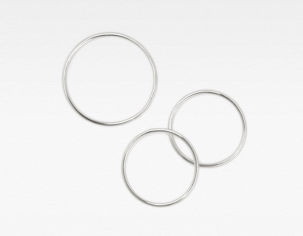 Set of three white gold skinny stacking rings