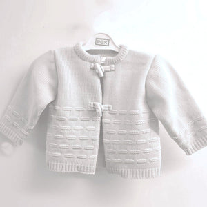 White cardigan for baby. White baby cardigan with toggles fastening.White baby cardigan by Pex.