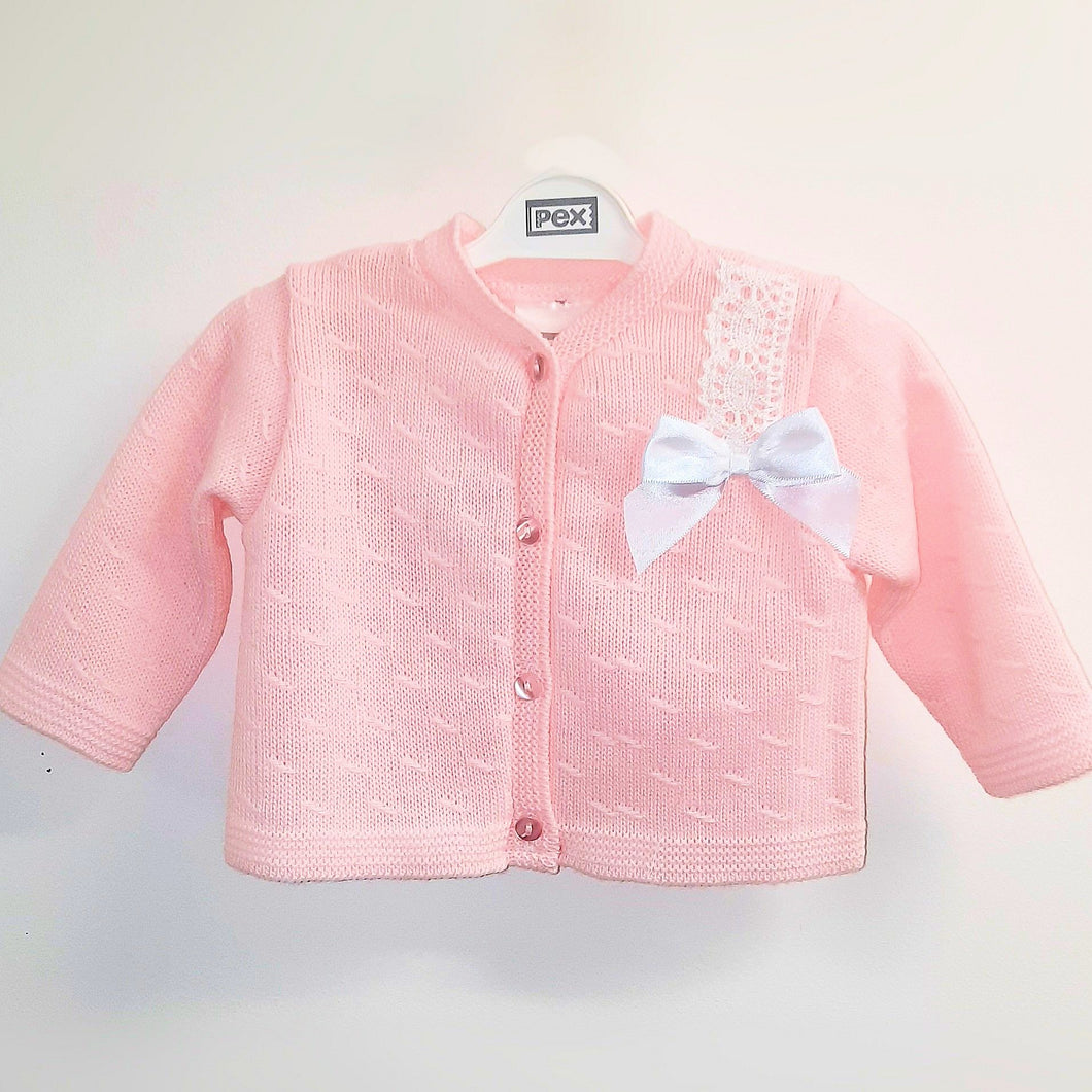 Pink baby girl's cardigan with white satin bow.