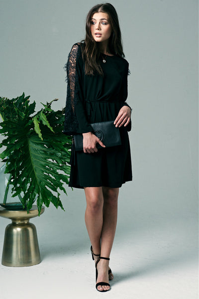 Bishop + Young black dress with bell sleeves and lace details