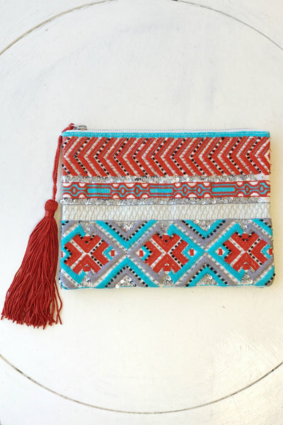 Hand beaded clutch with tassel