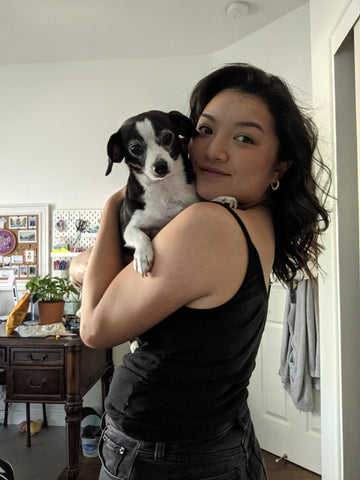 Asian woman with a dog
