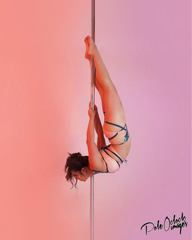 Asian pole dancer hanging upside down