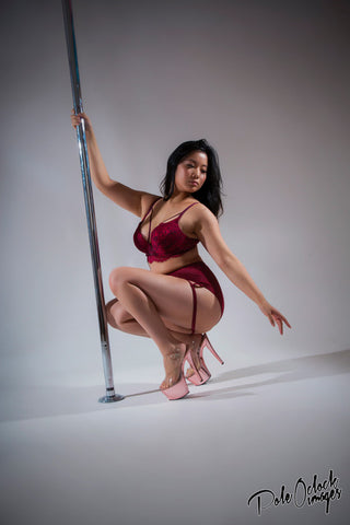 Asian pole dancer in red lingerie set