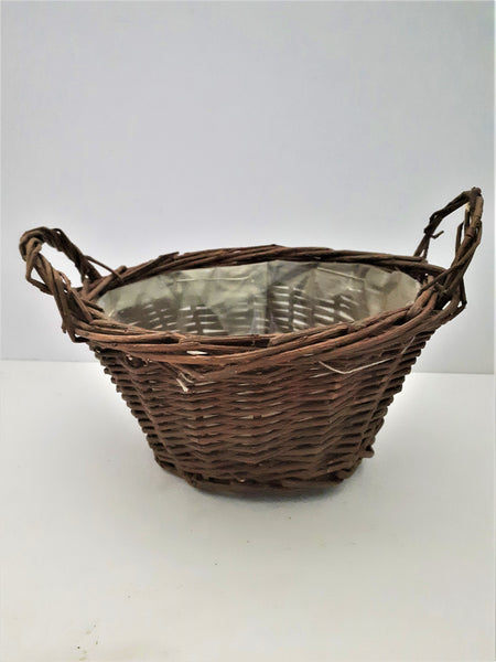 18CM Empty indoor brown round basket with ears.