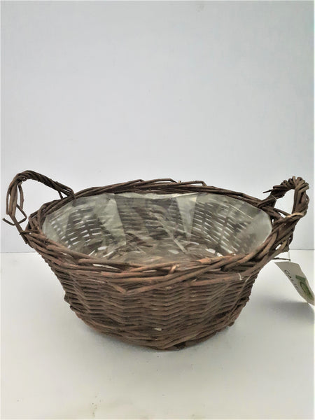 24CM Empty indoor brown round basket with ears.