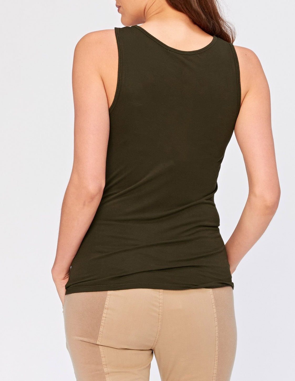 Made of luxuriously soft jersey this tank make a great layering piece that works with both our Wearables & XCVI Collections. Mix and match for a perfect look.  Jersey body - 100% Rayon. Preshrunk. Machine washable. Imported.