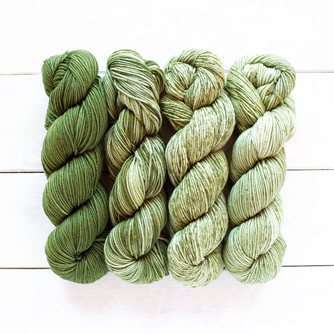 Four 50 gram skeins that fade into each other in fingering weight yarn, gradient kit, fade,