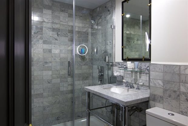 The Academy Hotel, London - hotel bathroom with chic stone tiling and walk in shower