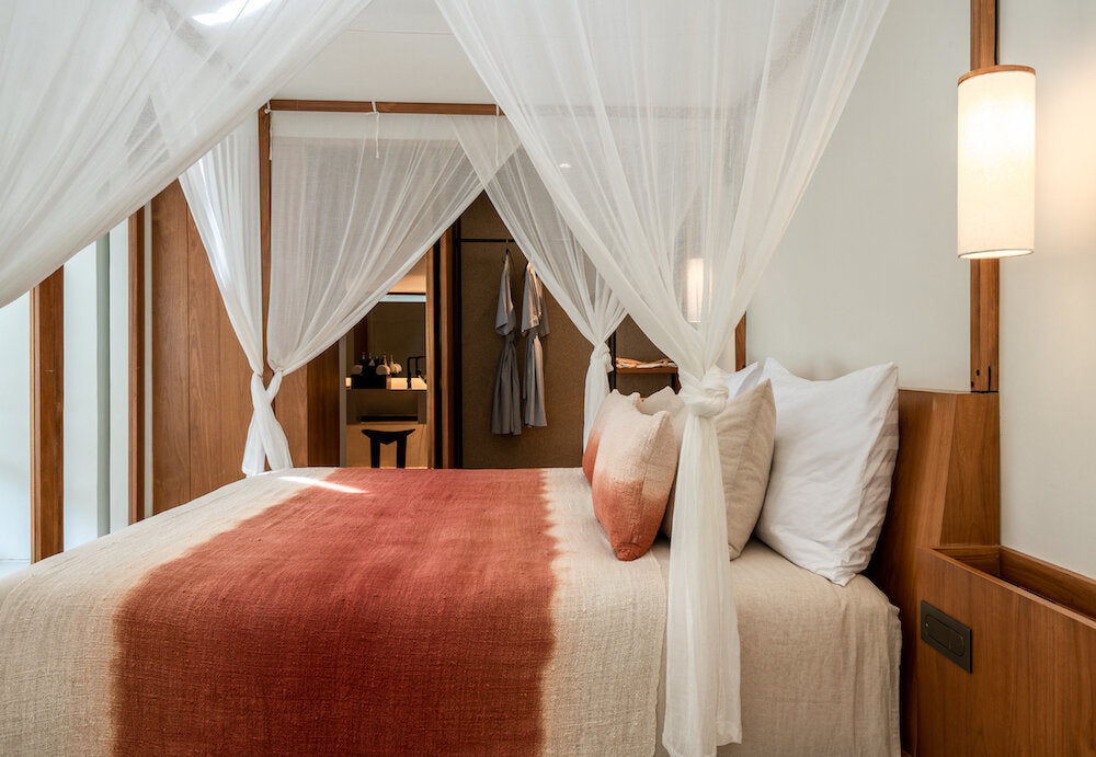 Bisma Eight, Bali - hotel room with a king size canopy bed and cloth curtains