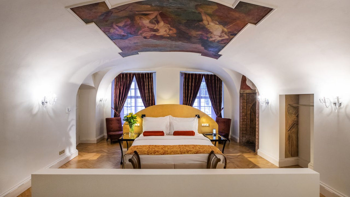 Smetana Hotel, Prague - hotel room with white walls, Renaissance style ceiling fresco, and dark patterned curtains