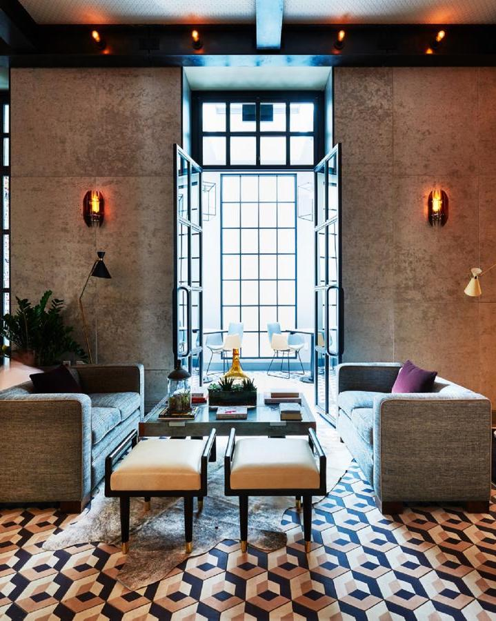 Sixty Soho, NYC - contemporary hotel lobby with grey furniture, geometric tiles, and large glass doors