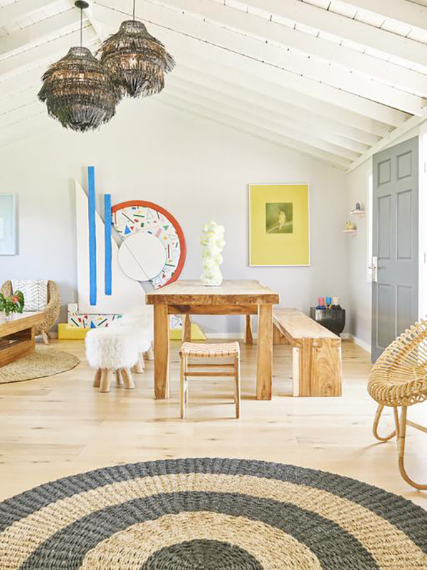 Hero Beach Club, Montauk - beach house style room with birch table, bench, and chairs