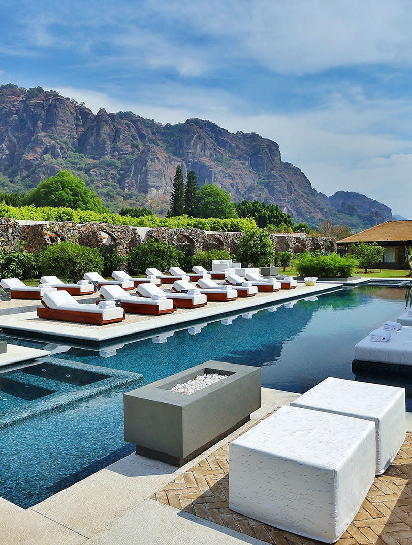 Amomoxtli, Tepoztlán - outdoor pool with lounge chairs and mountain view