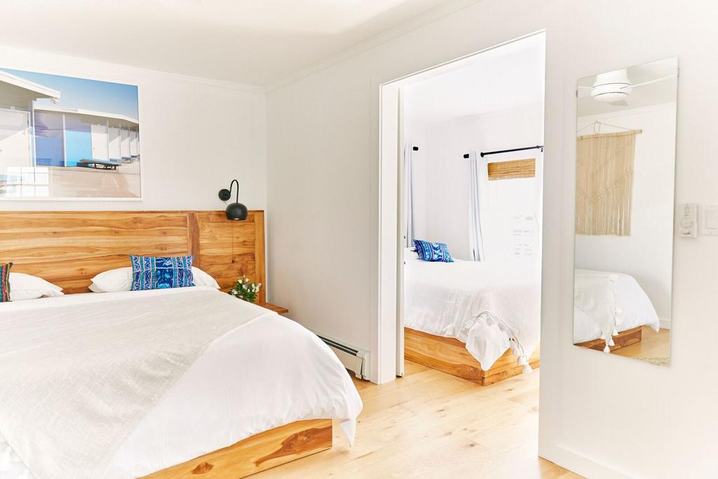 Hero Beach Club, Montauk - hotel room with two bedrooms, white interiors, and birch furniture