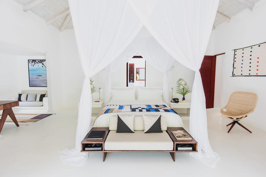 Hotel Esencia, Xpu-Ha - chic all-white hotel room with large curtain canopy bed, sofas, chairs, and high ceiling