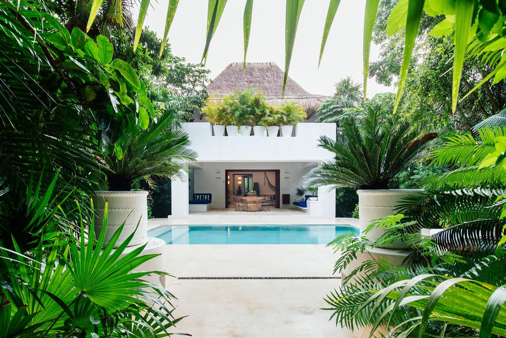 Hotel Esencia, Xpu-Ha - white patio with private pool and lounge chairs surrounded by jungle greenery