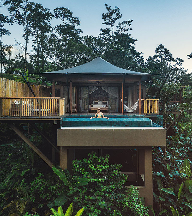 Nayara Resorts, Arenal - private jungle treehouse with woman in the pool