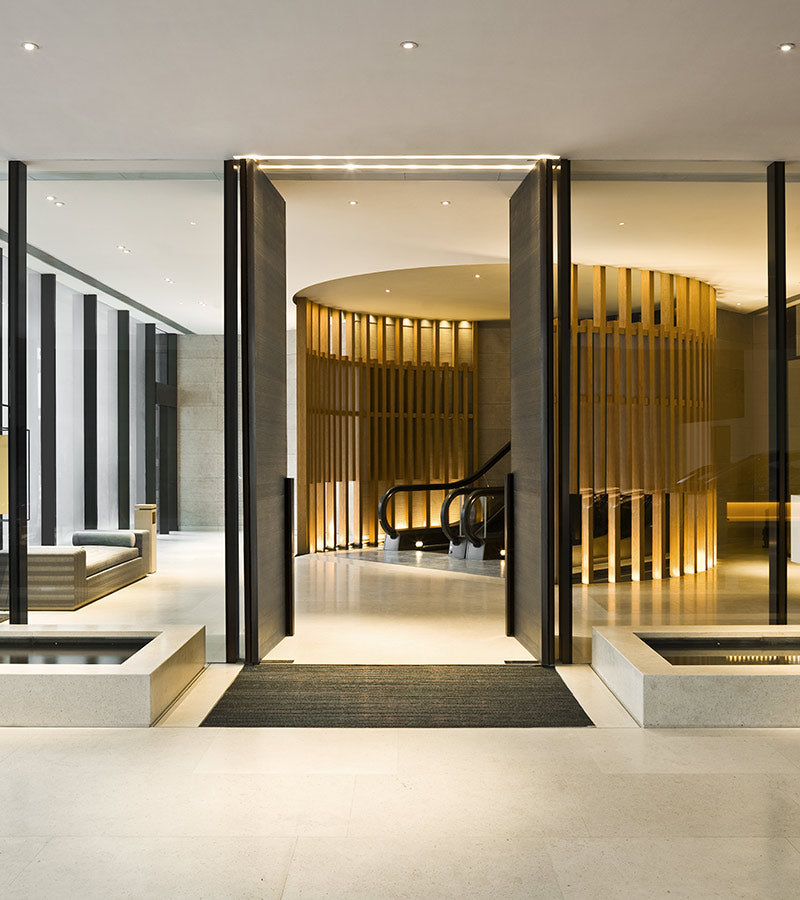 The Upper House, Hong Kong - hotel lobby with contemporary windows, doors, and escalator