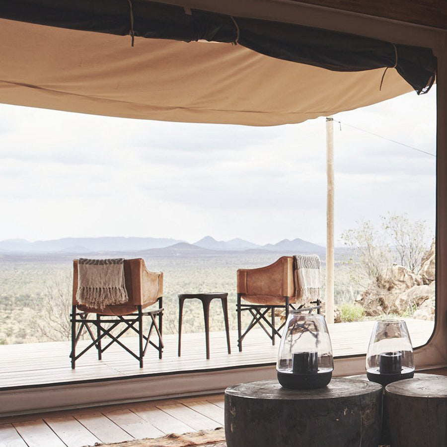 Habitas, Namibia - view from safari tent patio with canvas sun shade, chairs, and view of desert and mountains