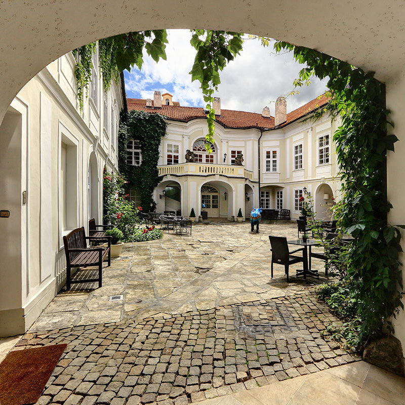 Smetana Hotel, Prague - hotel courtyard with ivy walls, patio furniture, and old world style