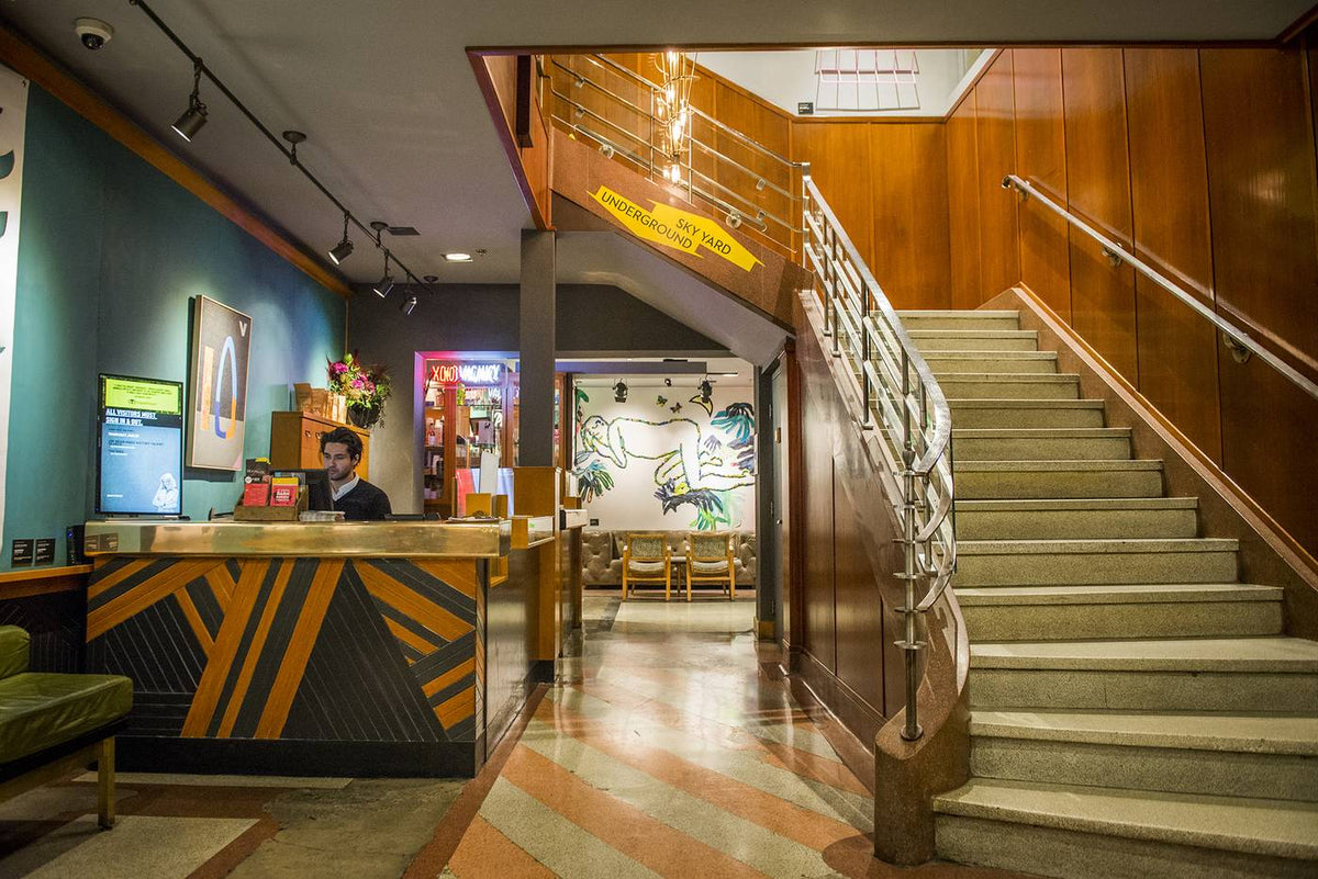 The Drake Hotel, Toronto - hotel lobby with retro reception desk and grand stone staircase