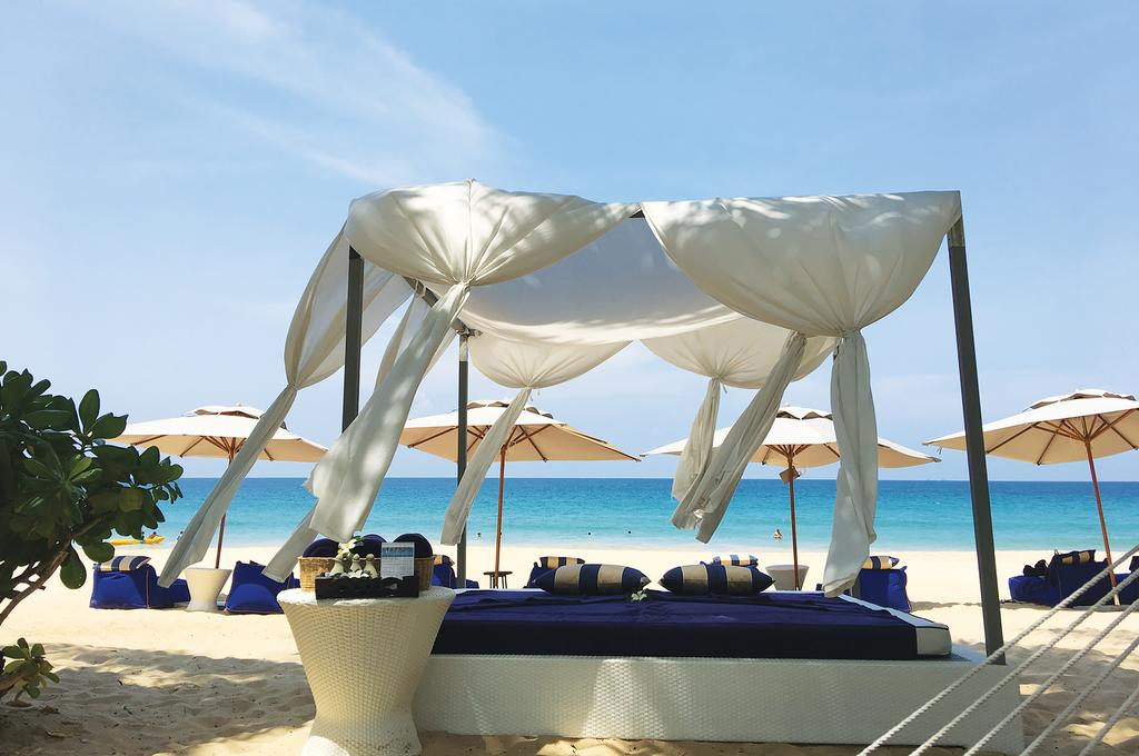 Akyra Beach Resort, Phuket - beach resort with lounges and an outdoor massage table