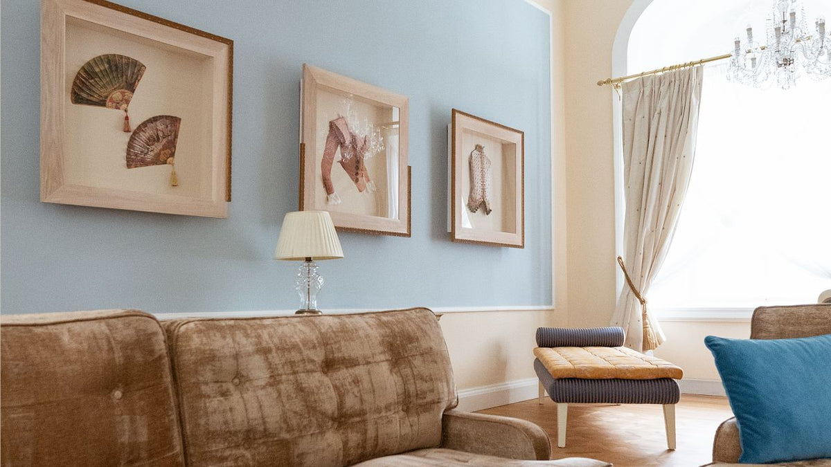 Smetana Hotel, Prague - hotel room with light blue, beige, and brown furniture and framed vintage accessories on wall