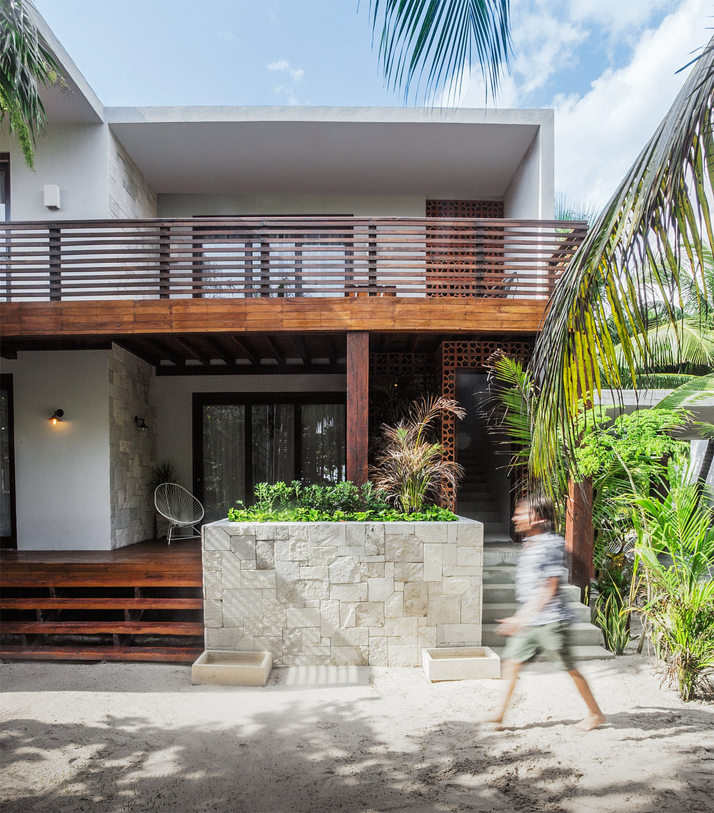 Sanará, Tulum - chic villa with patio, balcony, and simple wooden accents to white building