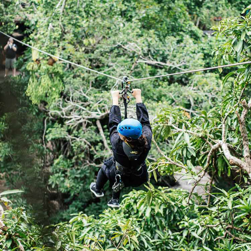 Shinta Mani Wild, Kirirom National Park - person on a zip line riding through jungle