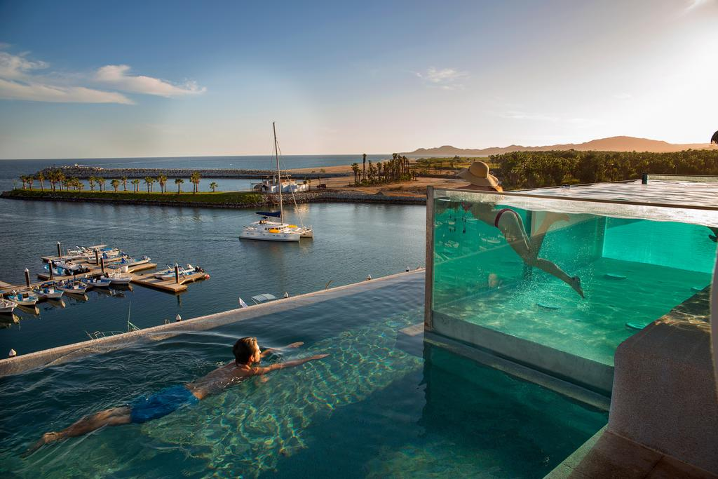 Hotel El Ganzo, Los Cabos - glass pool overlooking another infinity pool with marina and ocean view