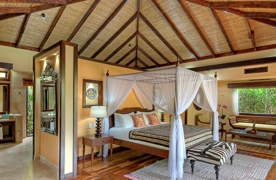 Nayara Resorts, Arenal - naturalistic hotel room with wooden accents, canopy bed, and jungle view