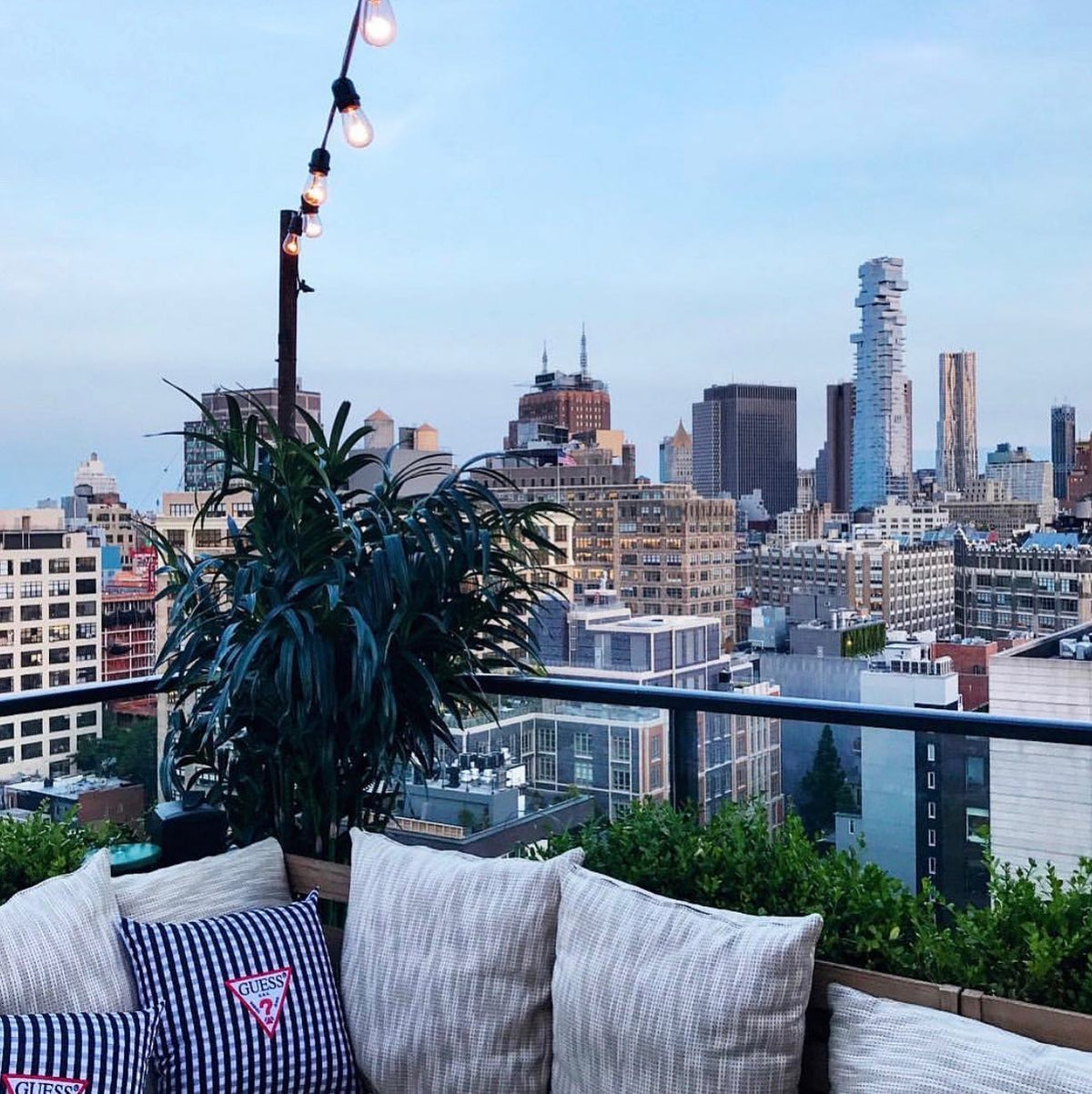 Hotel Hugo, NYC - rooftop lounge view of New York City at sunset