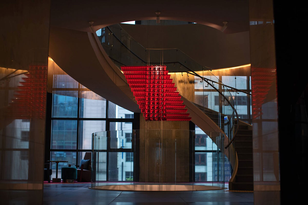 RYSE, Seoul - hotel lobby with large modern spiral staircase and red hanging art mobile in the center